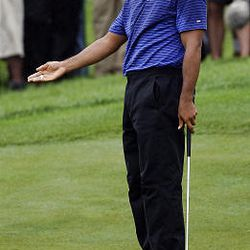 Tiger Woods gestures toward the ball as he misses a putt on the third hole during the third round of The Barclays golf tournament, Saturday.