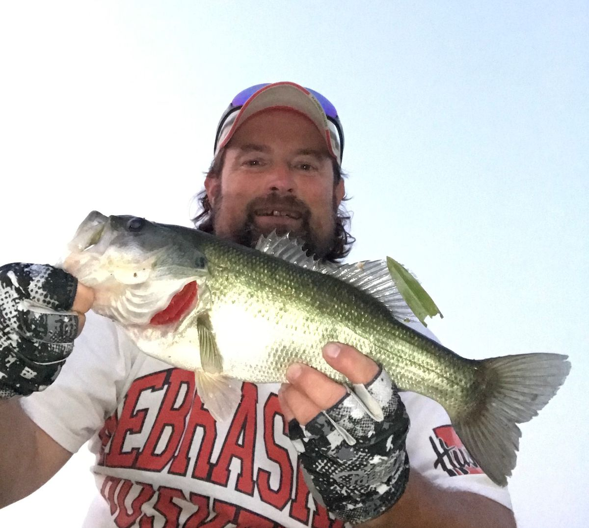 """Ken """"Husker"""" O'Malley with a late summer largemouth bass. Provided photo"""