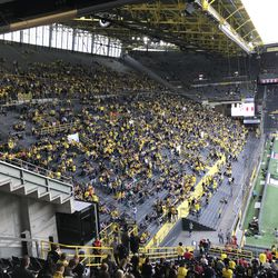 The Yellow Wall gradually fills up for the DFL-Supercup, August 3, 2019. Normally the Yellow Wall is full of flag-waving ultras, but the ultras generally boycott games like the Supercup in protest of the commercialization of the game.