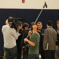 The media horde around Geno Auriemma after USA Women's Basketball practice.