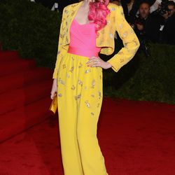 Coco Rocha in vintage Givenchy, Sergio Rossi heels, and a Kotur clutch in 2012.