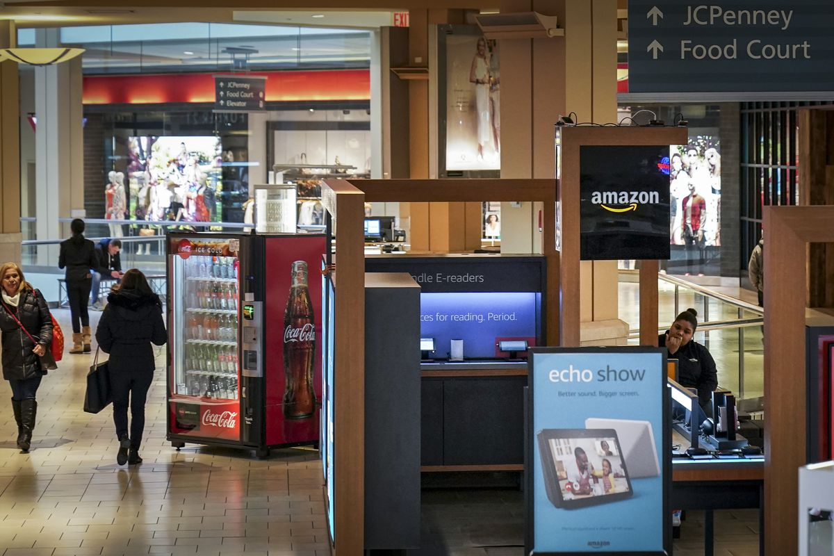 An Amazon Pop-Up kiosk-style store stands inside the Queens Center Shopping Mall, March 7, 2019 in the Queens borough of New York City. According to a report from The Wall Street Journal, the online retailer plans to close all 87 of its pop-up kiosks in m