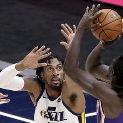 Utah Jazz center Derrick Favors (15) guards Phoenix Suns forward Johnathan Motley (12) as he shoots during a preseason NBA game at the Vivint Smart Home Arena in Salt Lake City on Monday, Dec. 14, 2020. The Jazz beat the Suns 111-92.