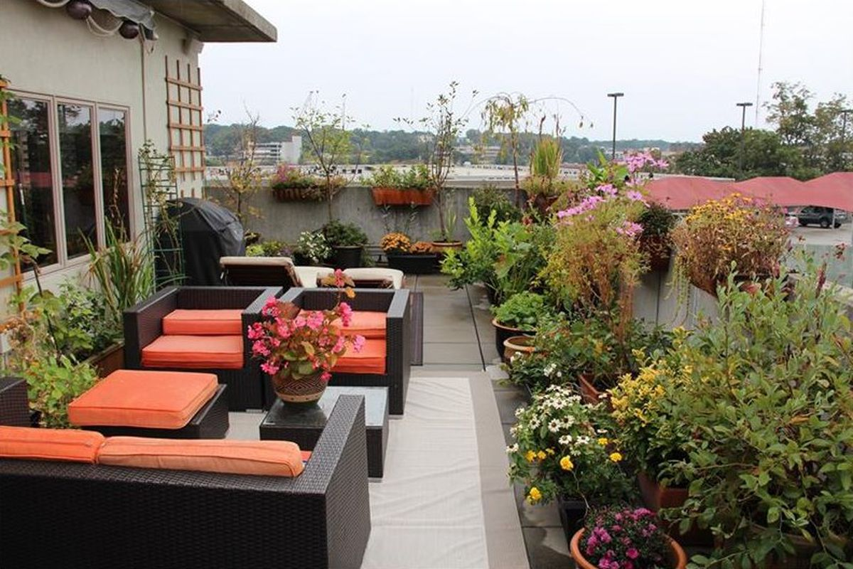 A plant-filled patio with an Old Fourth Ward townhouse for sale in Atlanta right now.