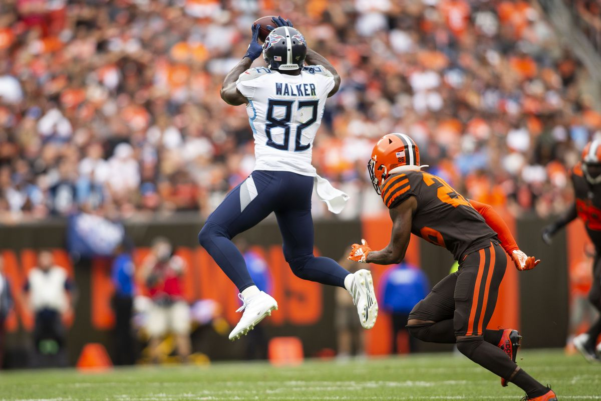 Tennessee Titans tight end Delanie Walker makes a reception for a first down under coverage by Cleveland Browns cornerback Greedy Williams during the second quarter at FirstEnergy Stadium.