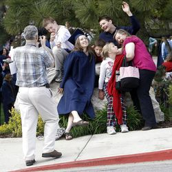 The Davis family take a photo with their daughter and sister Laura who walked during the Spring Commencement Exercises  at BYU Thursday, April 19, 2012 in the Marriott Center.