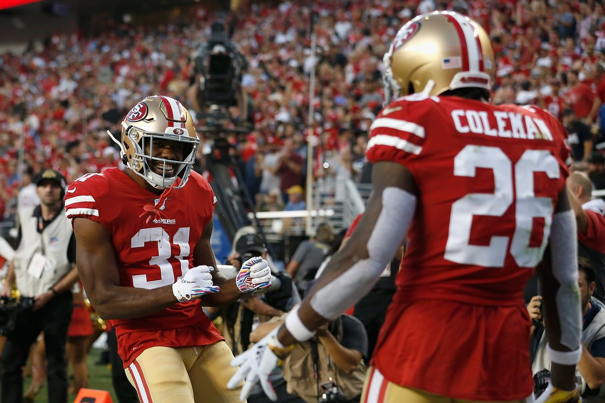 Tevin Coleman #26 of the San Francisco 49ers celebrates with Raheem Mostert #31 after scoring a touchdown in the second quarter against the Cleveland Browns at Levi's Stadium on October 07, 2019 in Santa Clara, California.
