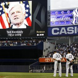 Nick Swisher, Jerry Hairston Jr. and Melky Cabrera of the New York Yankees observe a moment of silence for Sen. Edward M. Kennedy, D-Mass., on Wednesday before the Yankees' baseball game against the Texas Rangers at Yankee Stadium.