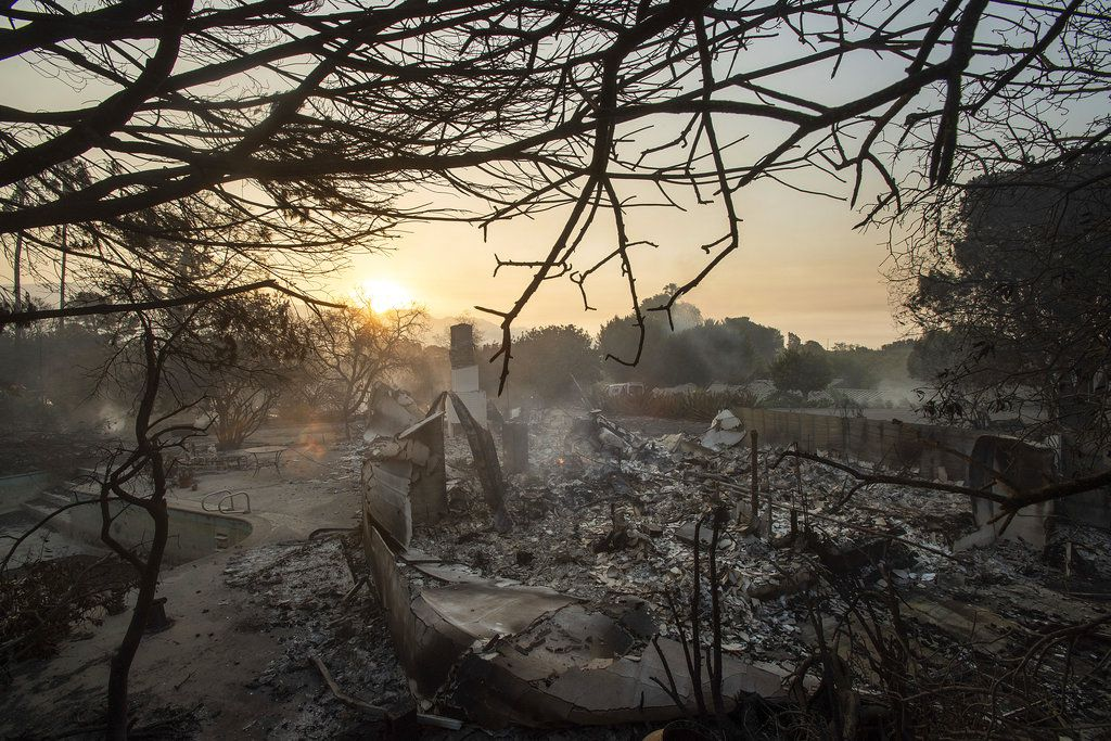 The sun rises behind a home leveled by the Holiday fire in Goleta, Calif., on Saturday, July 7, 2018.   AP Photo