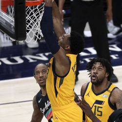 Utah Jazz guard Trent Forrest (3) dunks the ball as San Antonio Spurs forward DeMar DeRozan (10) and Utah Jazz center Derrick Favors (15) watch during an NBA game at Vivint Smart Home Arena in Salt Lake City on Monday, May 3, 2021. The Jazz won 110-99.