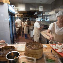 Cooks prepare food at Qing Xiang Yuan Dumplings.    Colin Boyle/Sun-Times
