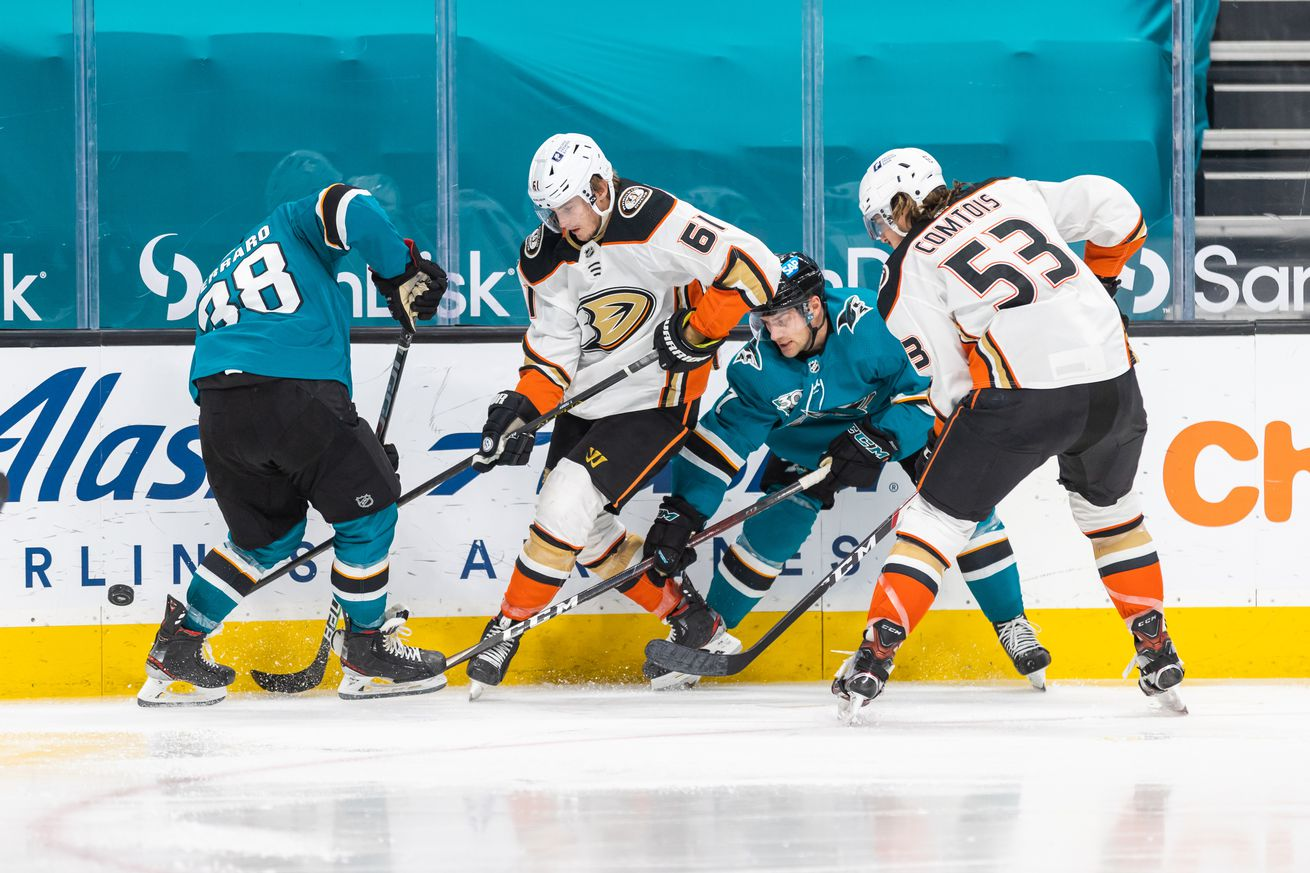 Anaheim Ducks Right Wing Troy Terry (61) scraps for the puck during the NHL hockey game between the Anaheim Ducks and the San Jose Sharks on April 14, 2021 at the SAP Center in San Jose, CA.