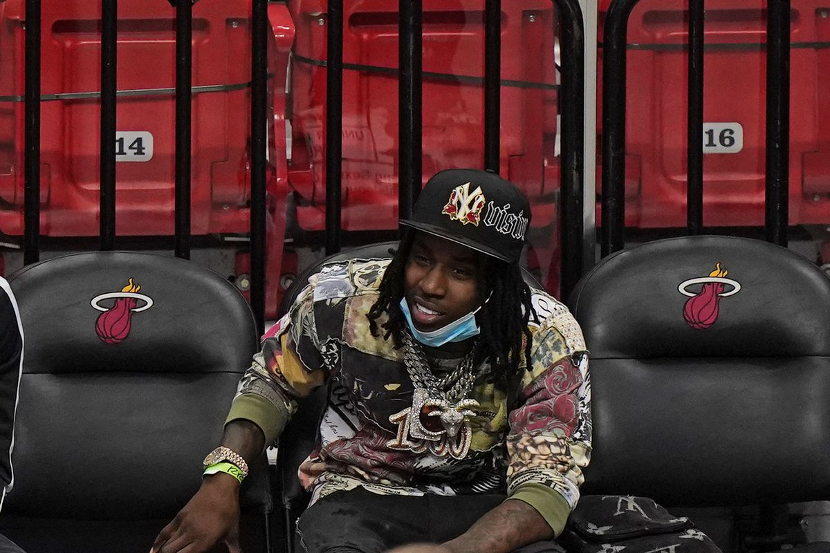 Rapper Polo G watches during the second half of an NBA basketball game between the Miami Heat and the Brooklyn Nets in Miami in April.