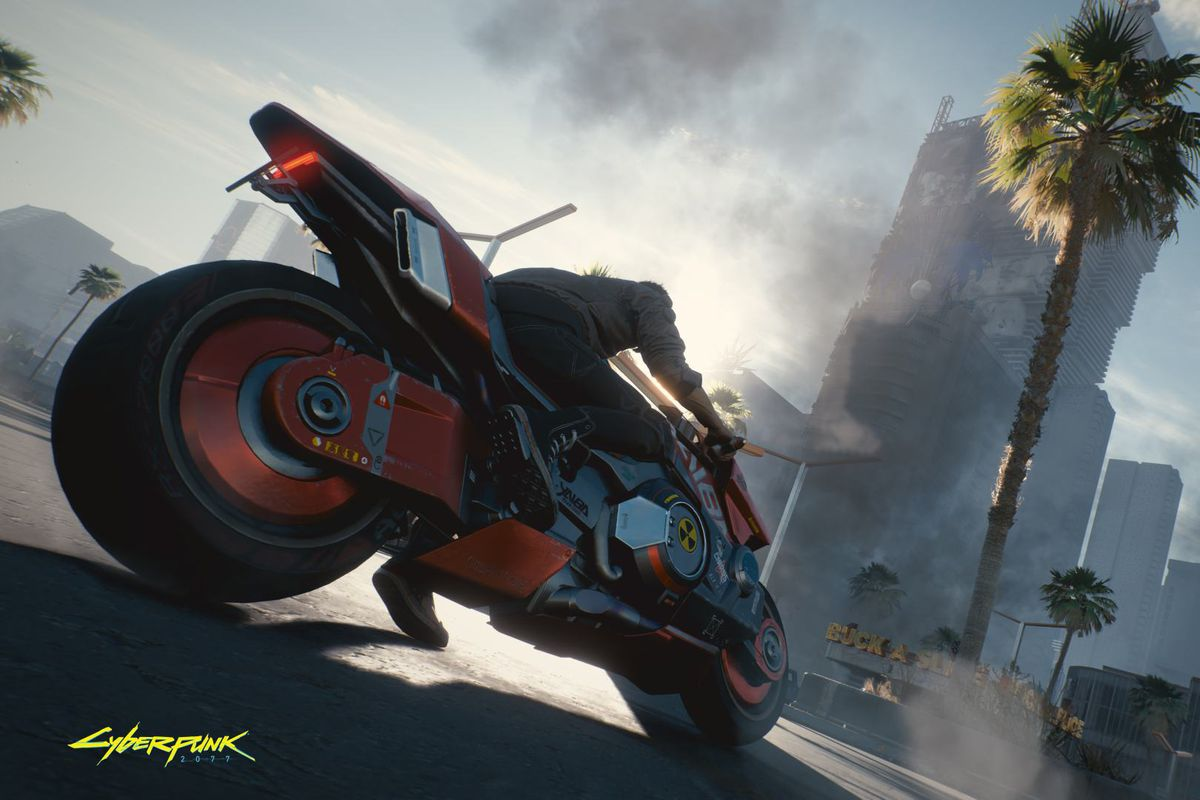 The main character, Vi, in Cyberpunk 2077 sits atop a nuclear-powered red motorcycle in Night City. In the background the city burns.