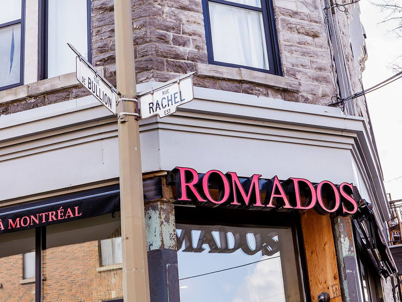 outside of restaurant with sign saying Romados