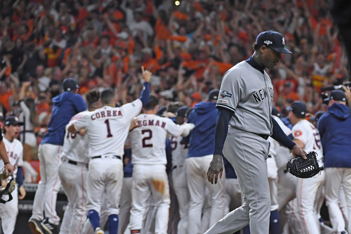 New York Yankees relief pitcher Aroldis Chapman walks off as the Houston Astros second baseman Jose Altuve hits a two-run home run in the ALCS Game 6