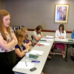 Sister Emily Veazey, from North Dakota, offers a closing prayer after sister missionaries gather at a training meeting for the Nevada Las Vegas Mission Friday, March 14, 2014, in Las Vegas.