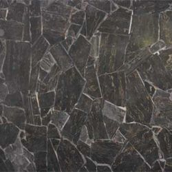 Black marble from the bank's main level was broken up to create mosaic patterns on the walls