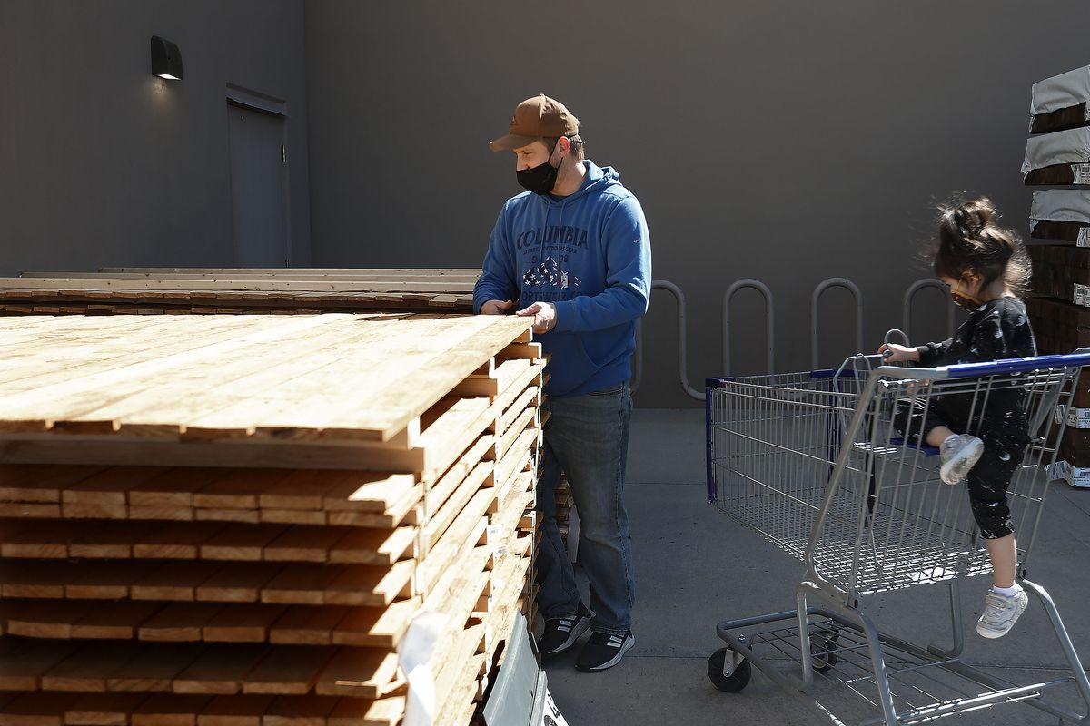 Kevin Sargent looks at fencing with his daughter, Emilia, at a Lowe's in Salt Lake City on Wednesday, April 7, 2021. Sargent will be using his federal stimulus check to pay for the fencing that he is planning to install himself.