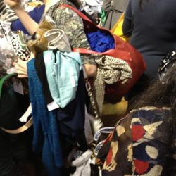 This pile of patterns and fabric is actually a girl who has about 40 items. She plowed her way through the place.