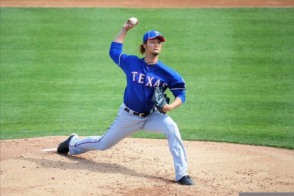 Mar. 7, 2012; Peoria, AZ, USA; Texas Rangers pitcher Yu Darvish pitches in the first inning against the San Diego Padres at Peoria Stadium.  Mandatory Credit: Mark J. Rebilas-US PRESSWIRE
