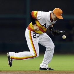 Houston Astros shortstop Tyler Greene (23) loses the ball while trying to field a hit by Pittsburgh Pirates' Rod Barajas during the third inning of a baseball game Sunday, Sept. 23, 2012, in Houston. Barajas was safe at first and Greene was charged with an error on the play.