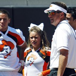 Oklahoma State head coach Mike Gundy, right, talks with cheerleaders during the half time of a spring NCAA college football game in Stillwater, Okla., Saturday, April 21, 2012.