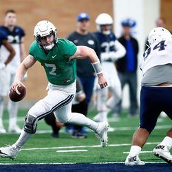 BYU quarterback Beau Hoge rolls out on a play during the Cougars' practice in the Indoor Practice Facility on Thursday, March 15, 2018 in Provo.