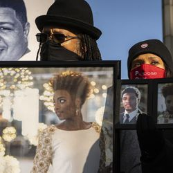 People held up signs and photos of loved ones lost to violence during a silent protest march Thursday along North Michigan Avenue.