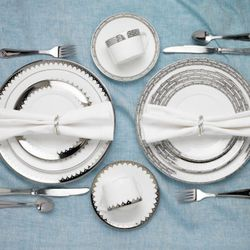 """""""When choosing your dinnerware, flatware, and glassware, you want to consider the size of your families to determine the number of settings you may need,"""" Gordon says. """"I recommend between eight to twelve place settings of your everyday dishes as a guide."""