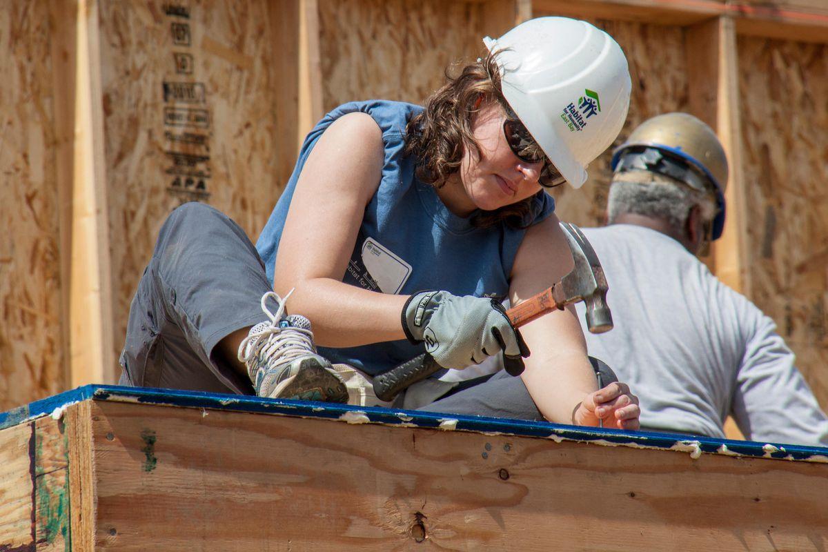 Habitat for Humanity volunteer hammering a nail.