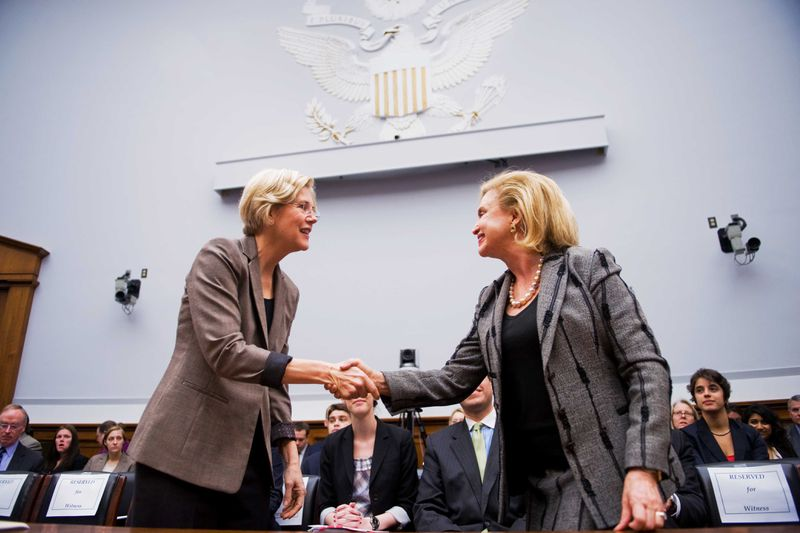 Elizabeth Warren shaking hands with Representative Carolyn Maloney in 2011.