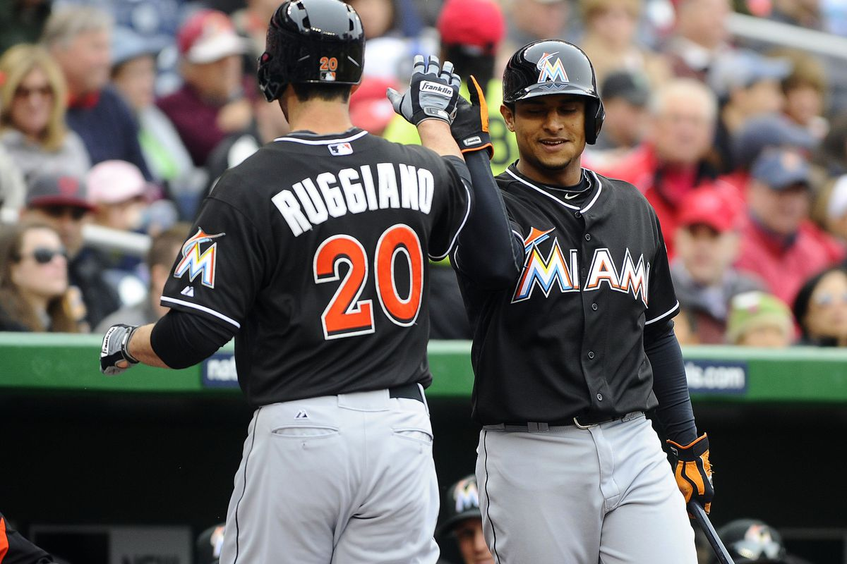 Miami Marlins outfielder Justin Ruggiano celebrates after hitting a home run and scoring the lone run of the Marlins' season thus far.