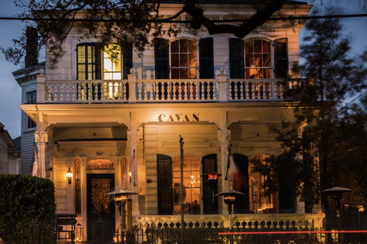 """An 1800s era Magazine Street mansion with """"Cavan"""" written on the door"""