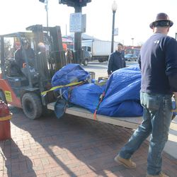 5:12 p.m. The Ernie Banks statue making its way. -