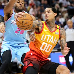 Utah Jazz guard Jordan Clarkson (00) fakes Miami Heat Andre Iguodala (28) as the Utah Jazz and the Miami Heat play in an NBA basketball game at Vivint Smart Home Arena in Salt Lake City on Wednesday, Feb. 12, 2020.