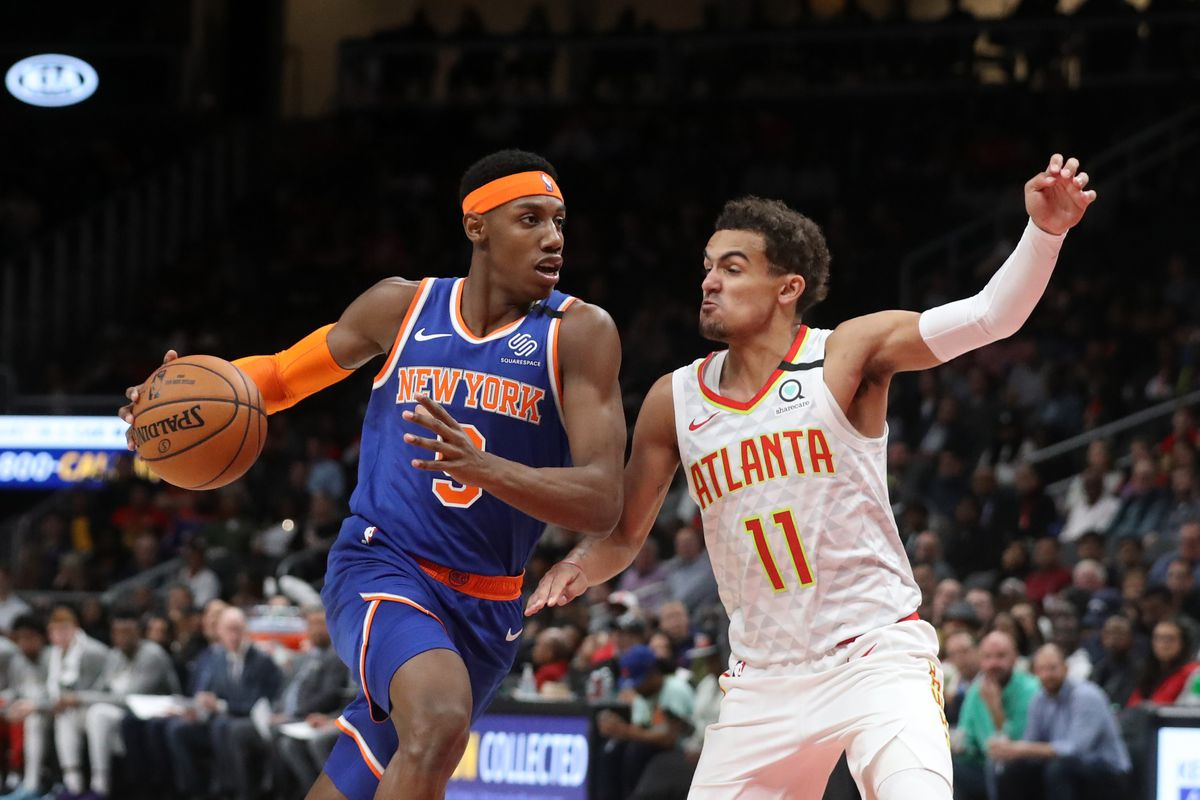 New York Knicks guard RJ Barrett drives against Atlanta Hawks guard Trae Young in the second quarter at State Farm Arena.