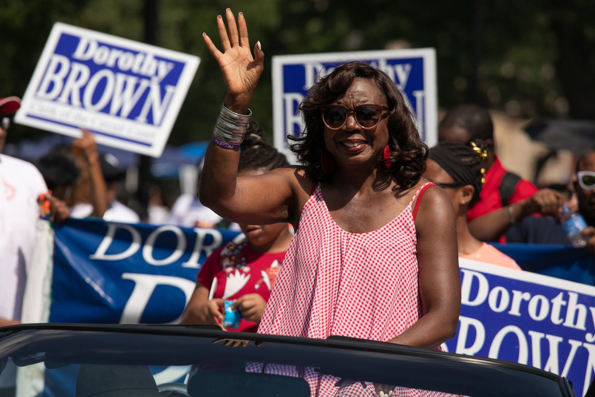 Dorothy Brown waves to paradegoers during the 90th Bud Billiken Parade in Bronzeville on August 10, 2019.