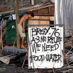 A sigh calls for help in Tacloban, Friday, Nov. 22, 2013.