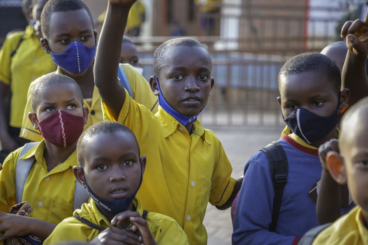 Tresor Ndizihiwe (center) plays with his friends after school at the Kimihurura Primary School in Kigali, Rwanda. Tresor says he enjoys playing with others after months at home when he wasn't allowed to play with his friends or classmates because of the coronavirus pandemic.