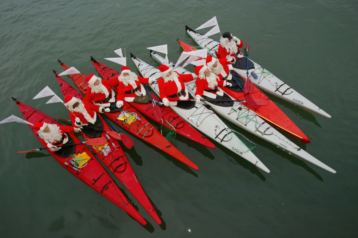 Santa Clauses' in McCovey's Cove to promote the movie
