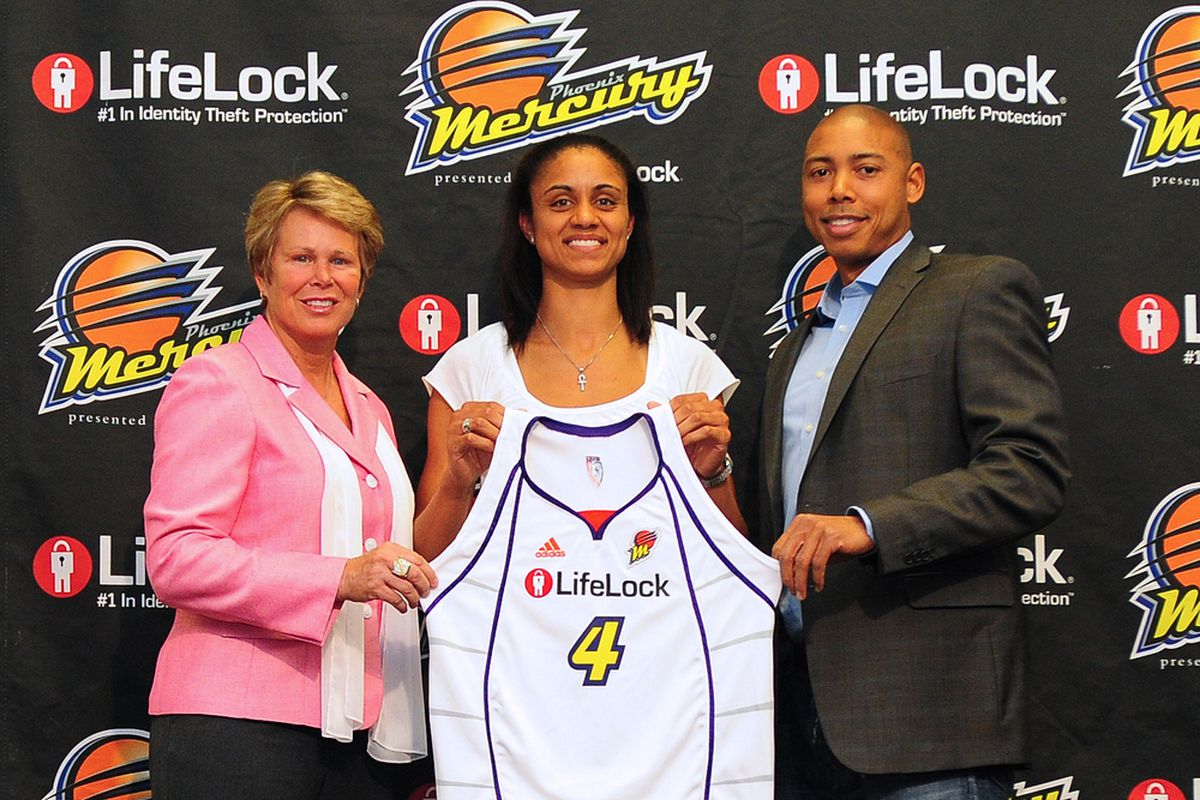 Candice Dupree who will wear number 4 for the Phoenix Mercury, is introduce by GM Ann Meyers-Drysdale and Coach Corey Gaines. (Photo Courtesy of Barry Gossage, NBA Photos)