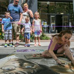 Emily Beck, right, works on a chalk piece featuring popular characters Harry Potter and Ron Weasley at the Utah Foster Care Chalk Art Festival at The Gateway in Salt Lake City on Saturday, June 18, 2016.