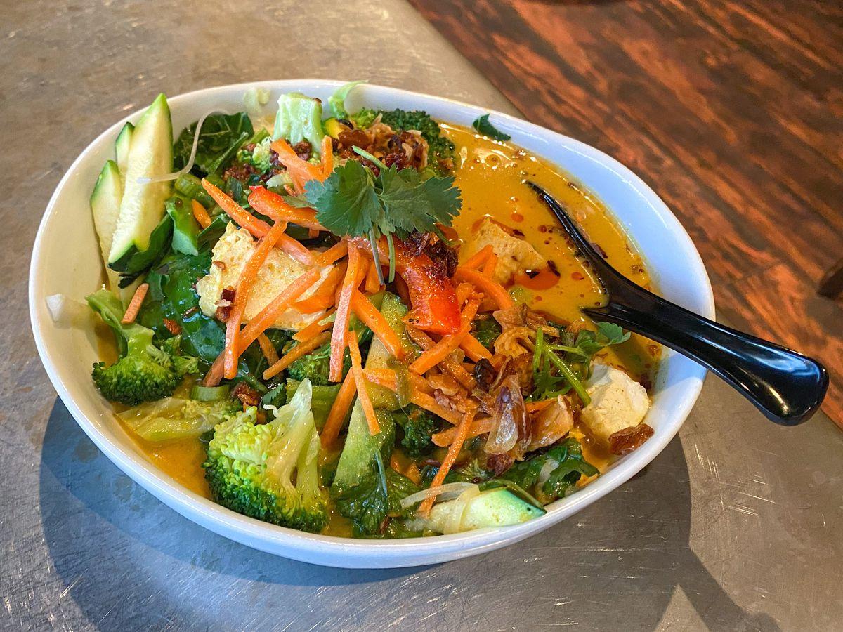 A photo of vegan laksa at Nudi Noodle Place