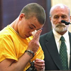 Ryan Dougherty wipes tears from his eyes in district court in Walsenburg, Colo., on Monday, April 30, 2012, where he was sentenced to 18 years in prison on charges stemming from he and his siblings shootout and capture in Colorado.  Attorney Michael Emmons looks on at right. All three siblings were sentenced on Monday. The three are accused of shooting at a police officer and staging a daring bank robbery in a cross-country crime spree that included Georgia and Florida. The manhunt for them ended after an Aug. 10 freeway chase and shootout with police in southern Colorado.