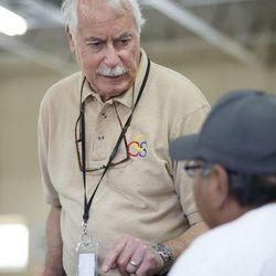 Dennis Kelsch, longtime employee of Catholic Community Services, speaks with a man who wished to remain anonymous at St. Vincent de Paul dining hall in Salt Lake City on Wednesday, May 31, 2017.