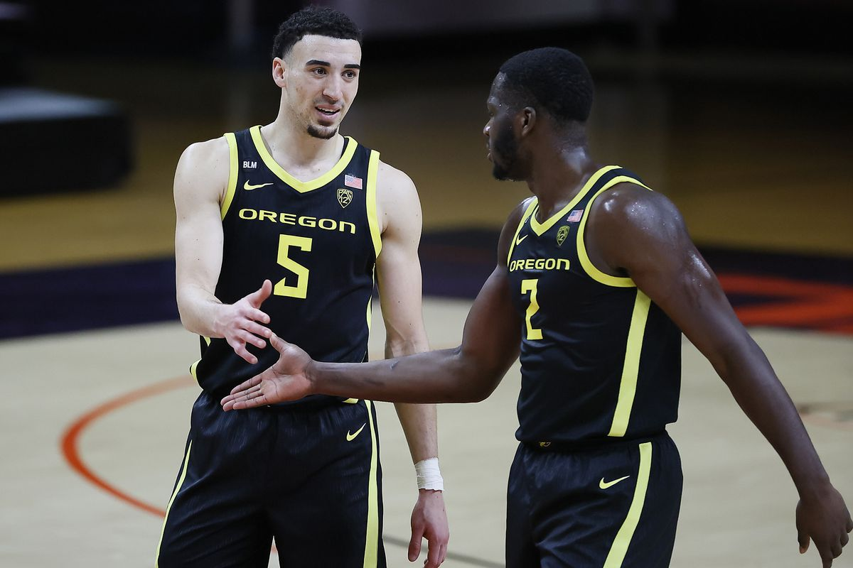 Chris Duarte and Eugene Omoruyi of the Oregon Ducks celebrate a basket during the second half against the Oregon State Beavers at Gill Coliseum on March 07, 2021 in Corvallis, Oregon.
