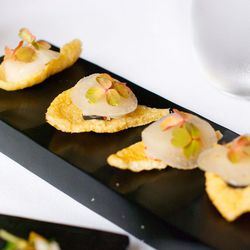 """Amuse Bouche of Scallop on a Chip with Pickled Daikon and Sesame from Eleven Madison Park by <a href=""""http://www.flickr.com/photos/gourmetgourmand/8079531023/in/pool-eater"""">gourmetgourmand</a>"""