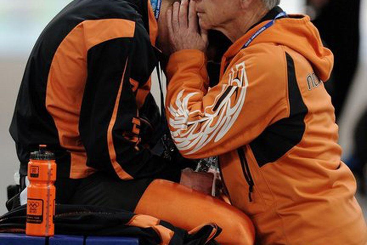 "Sven Kramer being comforted by Henk Gemser via <a href=""http://media.nj.com/olympics_main/photo/dutch-speedskater-sven-kramer-disqualification-olympics-b7f14e6b972b8045_large.jpg"">nj.com</a>"