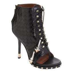 """<b>Givenchy</b>, <a href=""""http://www.barneys.com/Givenchy-Woven-Lace-Up-Ankle-Boot/502396072,default,pd.html?cgid=BARNEYS&index=8"""">$1.950</a>"""